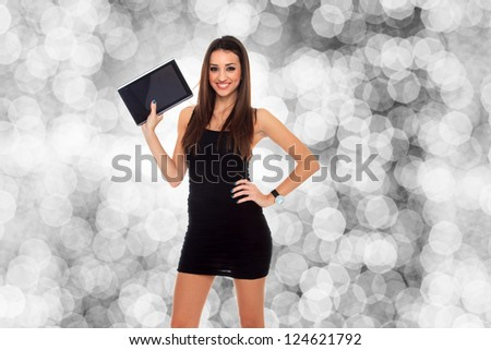 Business woman using a table PC - stock photo
