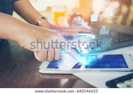 Business woman using a tablet to analysis marketing with digital light.