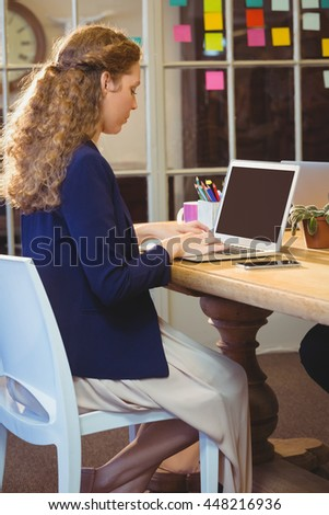 Business woman using laptop at work