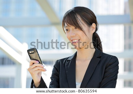 business woman using mobile cell phone - stock photo