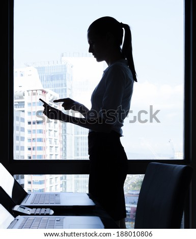 Business woman using mobile smart phone.