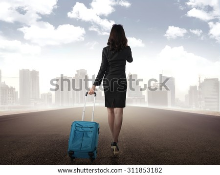Business woman walking alone on the street to the city