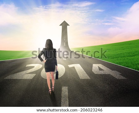 Business woman walking on the right way to improve her career