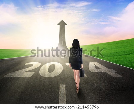 Business woman walking on the road going up as an arrow