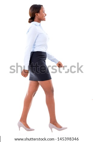 Business woman walking to the side - isolated over white background  - stock photo