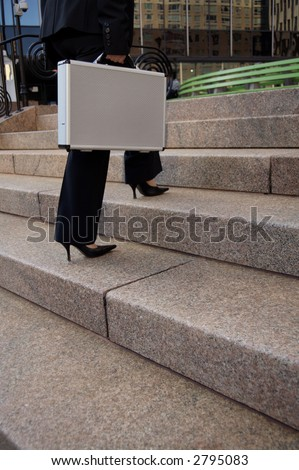 Business woman walking up stairs - stock photo