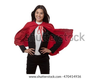business woman wearing a super hero cape shot in the studio