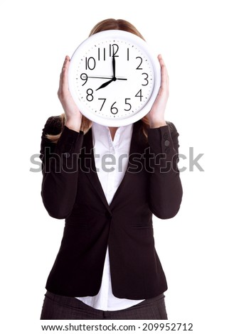 Business woman wearing formal suit and holding big clock on face, isolated on white background, punctual worker concept - stock photo