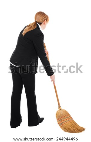 Business woman with a broom is cleaning the ground - stock photo