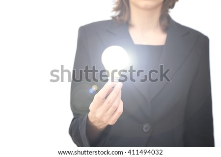 Business woman with a lit globe, without a Face - stock photo