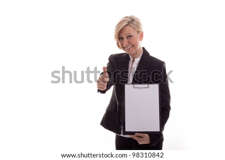 Business woman with a notepad lifts thumb - stock photo