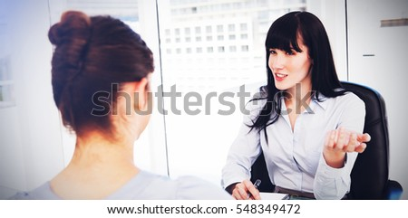 Business woman with a potential employee asks questions