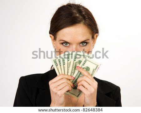 Business Woman with a wad of Cash Green Dollar Bills American Currency - stock photo