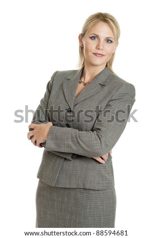 Business woman with arms folded isolated on a white background - stock photo