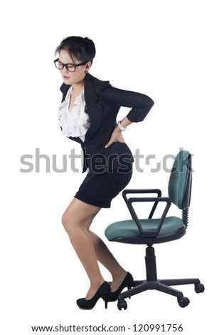 Business woman with backache after long work on chair. Isolated on white background, Model is Asian woman. - stock photo