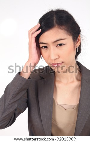 Business woman with bad headache holding head over white background