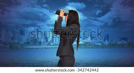 Business woman with binoculars over modern urban background.