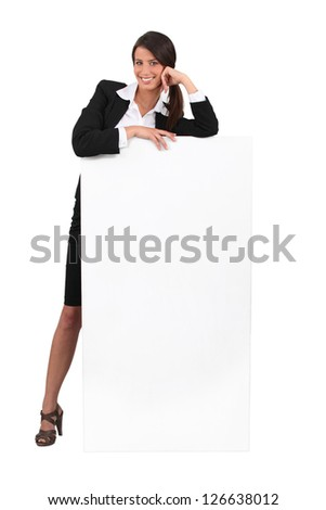 Business woman with blank poster - stock photo