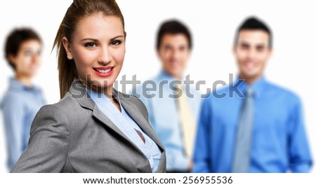 Business woman with colleagues in the background - stock photo