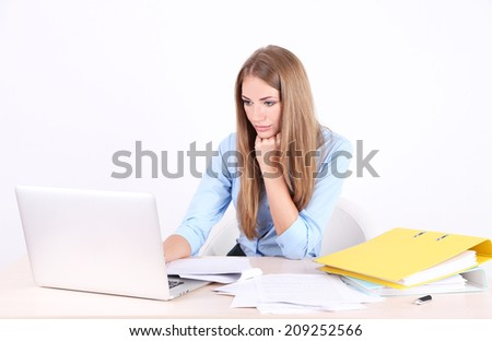 Business woman with documents at her workplace - stock photo