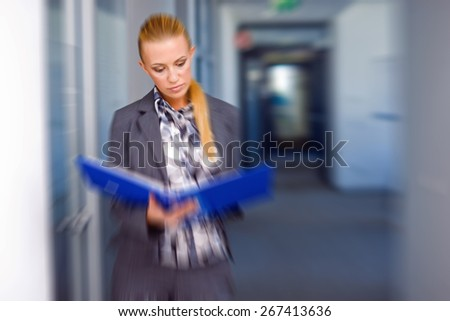 business woman with documents in the office, zoomed for dramatic effect - stock photo