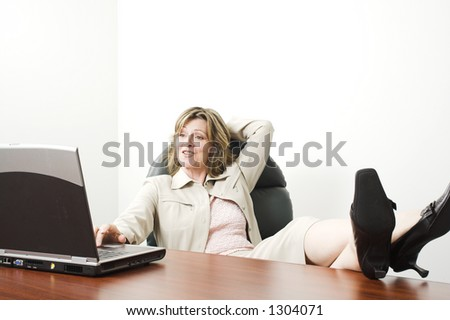 business woman with feet on table in boardroom