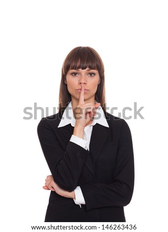 business woman with finger on lips, businesswoman isolated over white background - stock photo