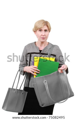 Business woman with folders in a bag - stock photo