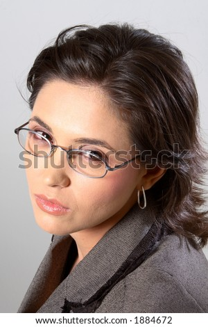 Business woman with glasses looking at the camera