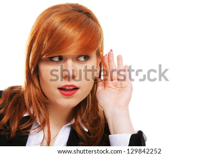 Business woman with hand to ear listening over white background. Gossip - stock photo