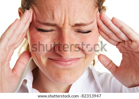 Business woman with headache massaging her aching temples - stock photo