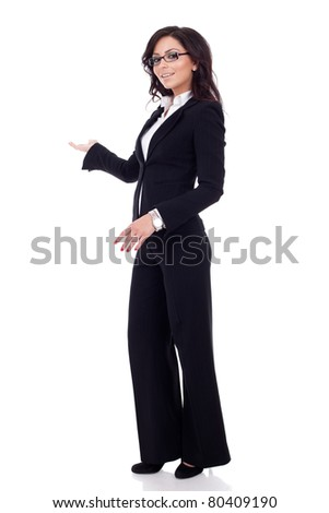 Business woman with her arm out in a welcoming or presenting gesture, isolated on white background - stock photo