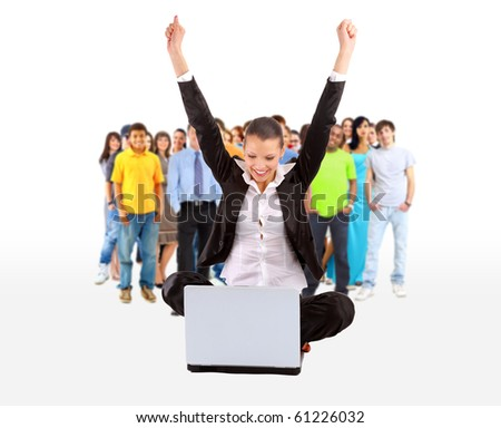 business woman with her hands raised while working on laptop - stock photo