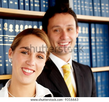 business woman with her partner in an office smiling - stock photo