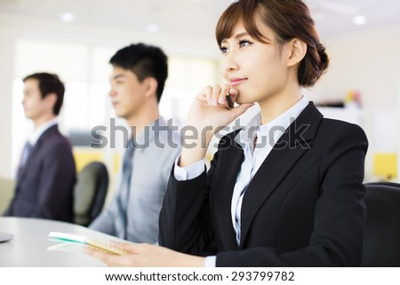 business woman with her staff in conference room - stock photo