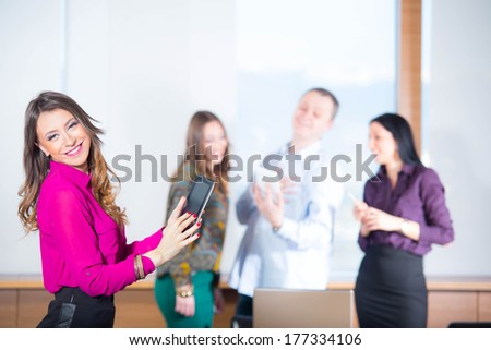 business woman with her staff, people group in background - stock photo