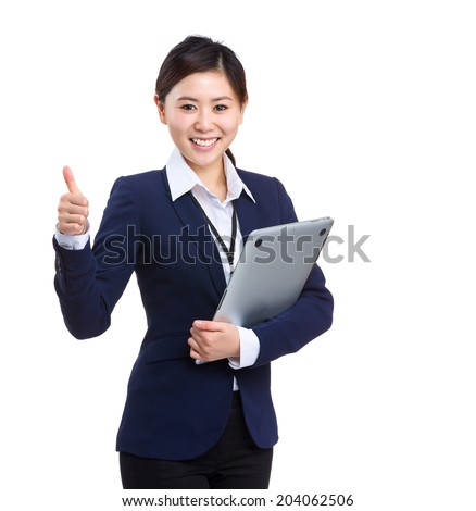 Business woman with laptop computer and thumb up - stock photo