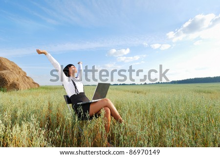 Business woman with  laptop on  agricultural field - stock photo