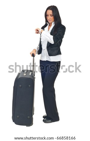 Business woman with luggage waiting and looking wristwatch checking time isolated on white background - stock photo