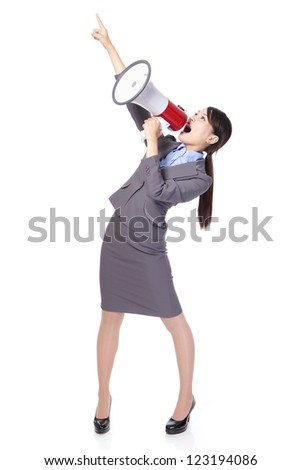 Business woman with megaphone yelling and finger pointing to empty copy space isolated on white background, asian model - stock photo