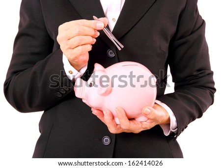 Business woman with piggy bank and tweezers in hand, close up