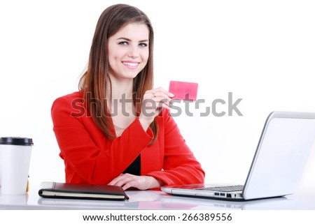 Business woman with plastic card working on laptop at office - stock photo
