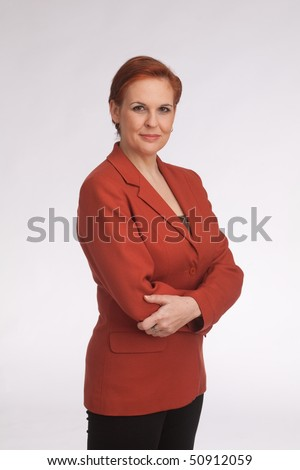 business woman with red sack coat and red hair