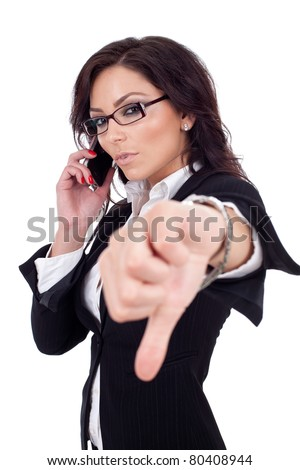 business woman with thumb down gesture and mobile phone - stock photo