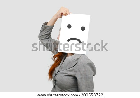 Business woman with white board and unhappy face. - stock photo