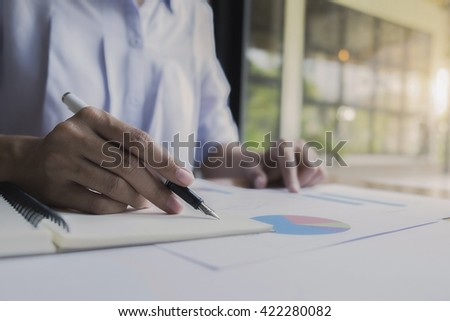 Business woman working at office with documents on desk at his office while looking serious consultant ,lawyer concept,morning light,vintage color,selective focus  - stock photo