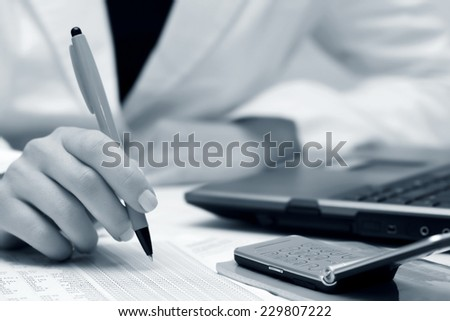 Business woman working financial accounting - stock photo