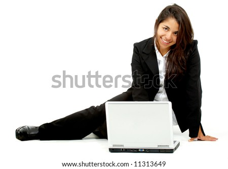 business woman working on a laptop computer on the floor isolated over a white background
