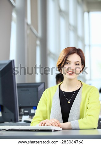 Business woman working on computer at office - stock photo