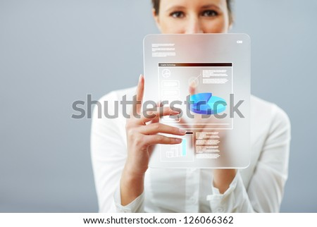Business woman working on her innovative digital tablet
